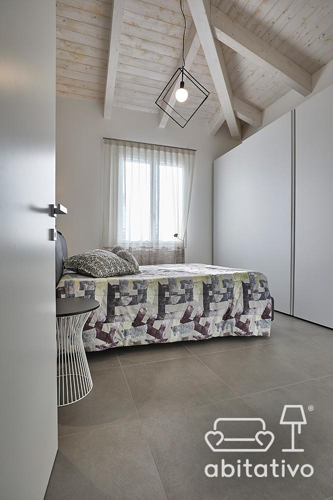 arredare camera da letto pavimento grigio